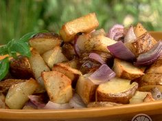 Food Network invites you to try this Vinegar-Coarse Salt Chipotle Roasted Potatoes recipe from Ingrid Hoffmann.