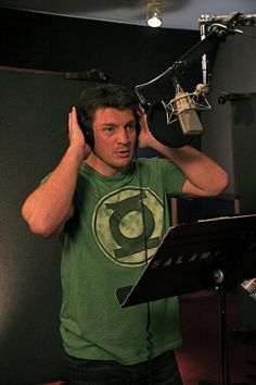 Nathan Fillion doing the voice of the Green Lantern in a Green Lantern shirt. This is why we love this guy.