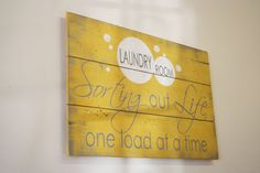 Cute sign for the laundry room! This is a wood pallet sign that measures 24 x 16. The background shown here is Bright Yellow with Gray.  $25