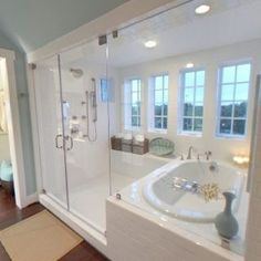 Enclosed tub/shower combo - just need dual shower heads and different tile and this is perfect. If wall next to tub was a connecting wall with the bedroom you could have a fireplace that's visible on both sides. by claudia Bad Inspiration, Bathroom Inspiration, Dream Bathrooms, Beautiful Bathrooms, Luxury Bathrooms, Bathroom Renos, Master Bathroom, Bathroom Closet, Wet Room Bathroom