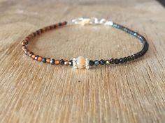 A personal favourite from my Etsy shop https://www.etsy.com/no-en/listing/601855489/black-spinel-and-orange-garnet-bracelet