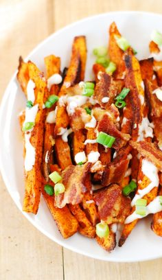 Spiced up sweet potato fries, baked to perfection and topped with chopped bacon! #gluten_free