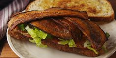 "Eggplant ""Bacon"" Lettuce and tomato sandwich         1 medium eggplant  2 tbsp. extra-virgin olive oil  2 tbsp. soy sauce  1 tsp. maple syrup  1/2 tsp. smoked paprika  1/2 tsp. Liquid Smoke  Freshly ground black pepper"