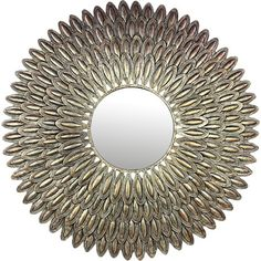 Featuring a textured sunburst design in a bronze-hued finish, this eye-catching mirror lends a pop of style to your walls.Product: