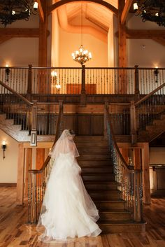 Bride on stair case at Heartland Place, 81 Ranch. Photography by Truly You