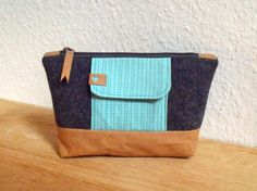 """Wool felt pouch and SnapPap with """"heart label"""" - just sewn. Felt Pouch, Clutch Pattern, Zipper Pouch, Cosmetic Bag, Wool Felt, Hand Sewing, Purses And Bags, Diaper Bag, Mini"""