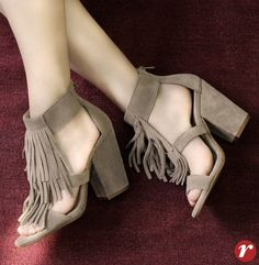 Love the chunky heel and the fringe.