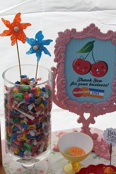 Its nice to offer a treat! Also consider framing your important info like payment options or pricing ittybittybirdy craft show display (2010)