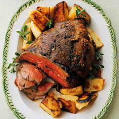 Roast Boneless Leg of Lamb with Potatoes, Lemon, and Marjoram