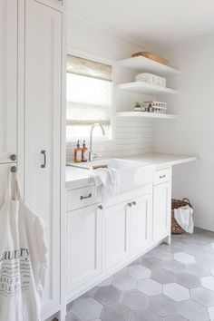 White laundry room with gray hexagon tile floor. White laundry room with gray hexagon tile floor. White laundry room with gray hexagon tile floor. White laundry room with gray hexagon tile floor. Laundry Room Tile, White Laundry Rooms, Laundry Room Shelves, Laundry Room Remodel, Laundry Room Organization, Room Tiles, Laundry Room Design, Basement Laundry, Laundry Storage
