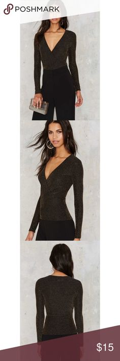 """Nastygal metallic surplice top Nastygal surplice long sleeve top in black and metallic gold nylon blend. Excellent like new condition with no visible signs of wear. Measures 17"""" from armpit to armpit and 23"""" from shoulder to hem. Nasty Gal Tops Blouses"""