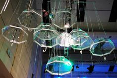 Clear umbrellas and glittering beads hung from the ceiling in the spring area. The sound of falling rain played in...