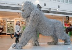 Photo Caption: The two-meter tall gorilla is the third of an edition of three entitled 'Silver Back' by the Turner Prize nominated artist David Mach. The first of which holds the Guinness World Record for the largest art installation made entirely from coat hangers. (AP Photo/Lefteris Pitarakis)