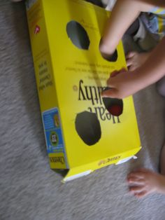 Baby play idea using balls and muffin tins for brain building, fine motor skill development, visual perceptual skills, perfect for sitting and mobile babies and Toddlers.