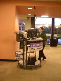 A roving reference desk at Cleveland Heights-University Heights Public Library… Teen Library Space, School Library Design, City Library, Dream Library, Library Ideas, Library Furniture Design, Information Kiosk, Library Signage, Reference Desk