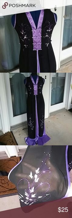 Traditional Vietnamese outfit (Ao Dai) Beautiful lavender purple and black 2 piece Vietnamese dress (tunic) with wide leg pants. In Vietnamese it is often called an Ao Dai. Top half of the part is lined, while the lower half is sheer to show off the pants. Has 2 long slits on the side so you can see the pants also. Tag says Small but may fit x-small as well. Dresses
