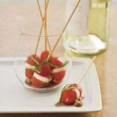 Mini Caprese Bites - like the idea of putting it in sandwich form and letting sit in a cup of balsamic