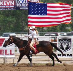 It takes a Rodeo Queen to run that flag