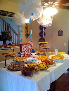 Boy baby shower with rain clouds and sports theme