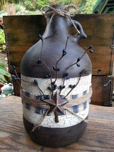 Hand painted and primitive decorated by Wendy Mayberry Wine Jug Crafts, Crafts With Glass Jars, Wine Craft, Mason Jar Crafts, Rustic Crafts, Country Crafts, Primitive Crafts, Primitive Candles, Wine Bottle Glasses
