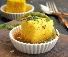 Dhokla Rasawala is a simple Gujarati dish made by soaking the classic khaman dhokla in a sweet and spicy gravy called rasa. Enjoy Rasawala Dhokla along with Gujarati Methi Thepla and Masala Chai for a filling and delicious breakfast with your family. Indian Appetizers, Indian Snacks, Indian Food Recipes, Jain Recipes, Indian Foods, Gujarati Recipes, Indian Desserts, Breakfast Recipes, Snack Recipes