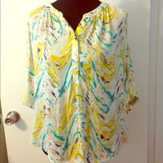 Lovely bright J.Lo shirt! Never worn. 100% polyester. Size Medium. Relaxed fit. Machine wash! Jennifer Lopez Tops