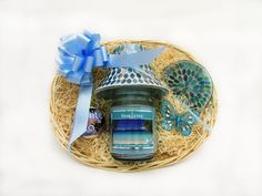 A Scented Soy Candle in a glass jar with a matching candle shade and saucer and a gorgeous scented Bath Bomb make up this beautiful gift set! Price: 29.99  http://luxuryhampers.ie/p/blue_candle_with_lid_saucer__bath_bomb