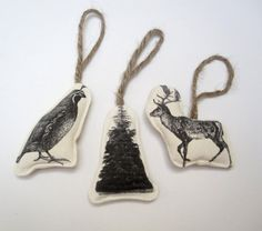 image ornaments  3/36.00  a set of three printed ornaments (a reindeer, a tree and a quail ) packaged in a drawstring cotton bag.