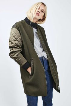 From topshop. http://us.topshop.com/en/tsus/product/quilted-sleeve-urban-coat-6148991