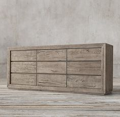 RH's Reclaimed Russian Oak 9-drawer Dresser:Handcrafted of solid reclaimed white oak timbers from decades-old buildings in Russia, our dresser is simple and functional in design. A salute to clean and contemporary style, each piece celebrates the unadorned beauty of salvaged wood.