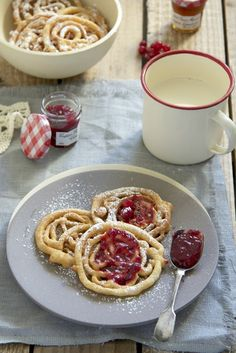 Funnel Cake -  225 gr. flour  30 gr. icing sugar  1 egg  320 ml. milk  1 tsp. baking powder  1.5 tsp. vanilla extract  1 tsp. brandy (optional)  a pinch of salt  Sunflower oil for frying  Icing sugar for dusting  (translated from Spanish)