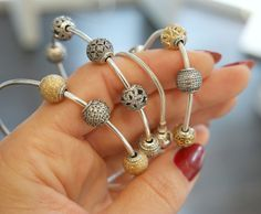 Mix gold and silver for a classic style. #PANDORATexas #PANDORAEssence