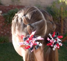 Puffy Braids with Instructional Video @ Princess Piggies.  This is a basic hairstyle but many still struggle with the steps so hopefully this will help.  :)