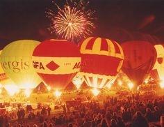 The Bristol International Balloon Fiesta, each August. Over 100 tethered balloons flash and illuminate like giant light bulbs to music, over the British countryside.