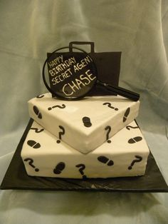 Secret agent birthday cake - Hard theme to work with but I figured it out. This was my first customer who didnt want filling! I was shocked haha.  Fondant/gumpaste briefcase, writing is royal icing, magnifying glass is real. Lots of fun.