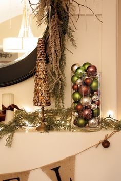 green and brown ornaments: do this with white and gold maybe blue ornaments