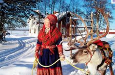 Here is a Sami woman in full dress of the with a reindeer. Sami people are the first people who inhabited Norway. Just like the Native Americans of America. They are known to follow the reindeer flocks to help them search for food during the year.