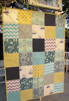 Patchwork quilt using chevron patches. Could be another option for the quilt In Hendrix's room