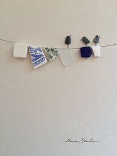 8 by 10 clothesline pebbke art with sea glass and by PebbleArt