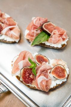 Fig Crostini with Ricotta Cheese, Prosciutto-easy hors d'oeuvre of grilled crostini smeared w/ricotta cheese, garnished w/figs, prosciutto & basil leaf.
