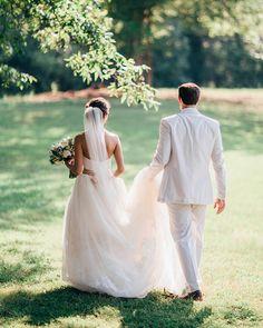 beautiful wedding photo idea - the groom holding the bride's train!  ~  we ❤ this! moncheribridals.com