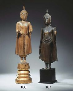 a thai, ayutthaya style, wood figure of buddha sakyamuni   18th/19th century   Standing on a separate carved circular base, both hands in abhayamudra, wearing samghati, his face with meditative expression, elongated earlobes, curled hairdress and usnisha, the latter surmounted by a flame, traces of gilt, red and black lacquer  77 cm high