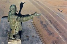 Daily Life: March 2014 - Photos - The Big Picture - Boston.com  In this aerial photo a woman walks past a statue of Soviet Union founder Vladimir Lenin at the Russian leased Baikonur cosmodrome, in Kazakhstan, on March 27. Baikonur is the world's first and largest operational space launch facility. (Dmitry Lovetsky/Associated Press) #