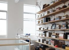 Paint the brackets to match the wall color so the shelves have the appearance of floating.