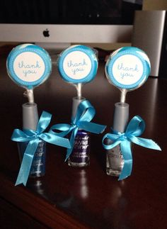 DIY Baby Shower Favors for Boy...Affordable! You can buy nail polish from Walmart for $0.93 each, set of 24 lollipops including ribbons & thank you stickers for $9.00.  Hot glue lollipops to nail polish, tie ribbons around, present in a basket or standing on the cake table.  #babyshower #blue #favors #DIY
