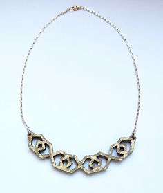 """Millie Jewelry Design - necklace inspired by the mexican tunics called """"huipiles""""; made from refurbished wood and gold vermeil."""