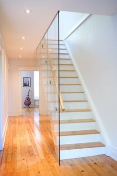 Glass replacing the bannister - without wood effect & would be nice to get rid of wood bannister too and have indentation on wall on other side