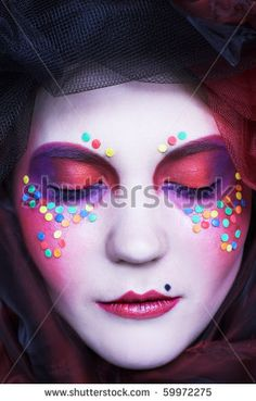 stock photo : Young lady in original hat with creative make-up in doll-style.