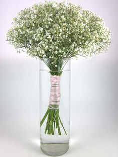 Baby's breath with hydrangeas mixed in tied with elegant ribbons-- the bouquets of the bridesmaids pulling double duty as table toppers?
