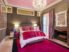 Great bedroom for a teen girl - girly touches like the bubblegum pink ceiling mixed with sophisticated furniture and accents.